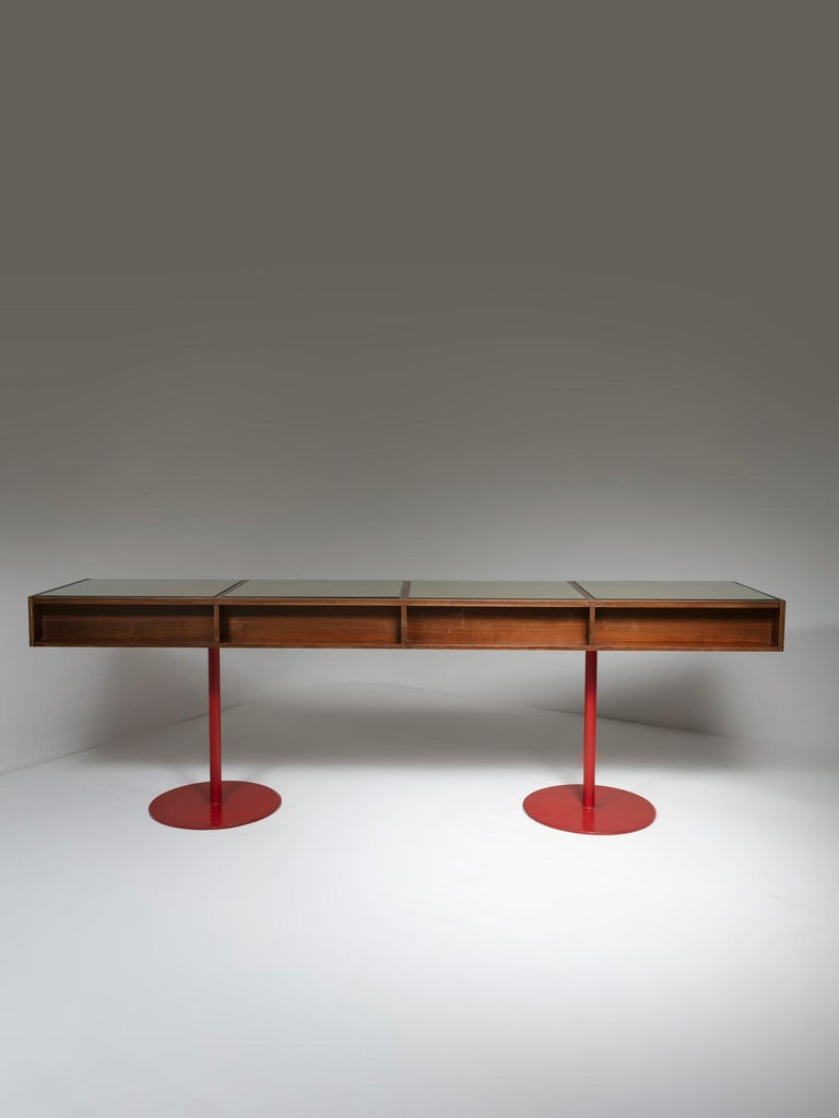 Generous wood counter with iron feet. top is visually divided on four squared areas with glass top. One side is equipped with several drawers. The piece comes from a commercial area on a Carlo Scarpa building.