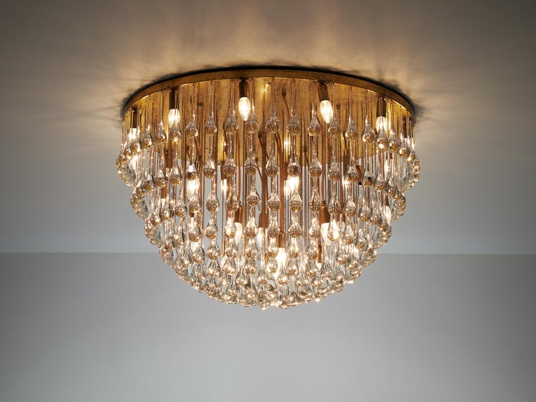 Italian chandelier, brass, glass, Italy, 1960s  Majestic Italian chandelier with a large amount of glass drops. This noble lamp creates a stunning light partition. The glass drops positioned on different heights combine together into a large