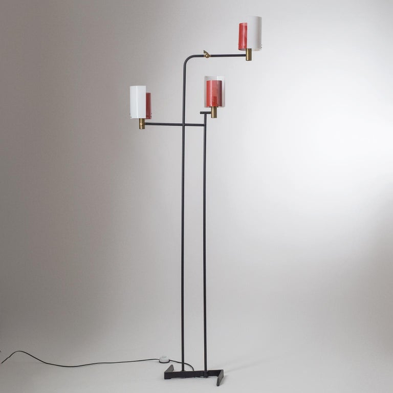 Rare large Italian three-arm floor lamp from the 1950s. Very unique modernist and sculptural design with black lacquered steel/iron structure and diffusers made of brass, acrylic and red perforated steel. Each arm has an original brass E14 socket