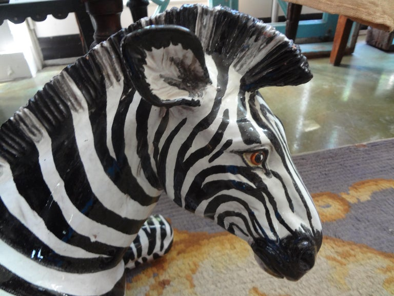 Stunning extra large vintage Hollywood Regency Italian glazed terracotta black and white reclining zebra figure or statue. This beautifully executed midcentury Italian glazed zebra sculpture is in very good condition.
