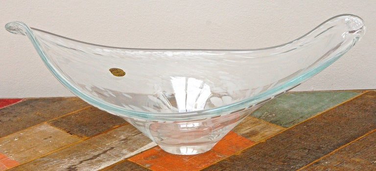 Hand made art glass bowl in clear glass with a beautiful white design, made in Italy. The bowl has a lovely curved organic shape. It is in very good condition, with some dents to the surface, and minor chips to the base. This large glass bowl