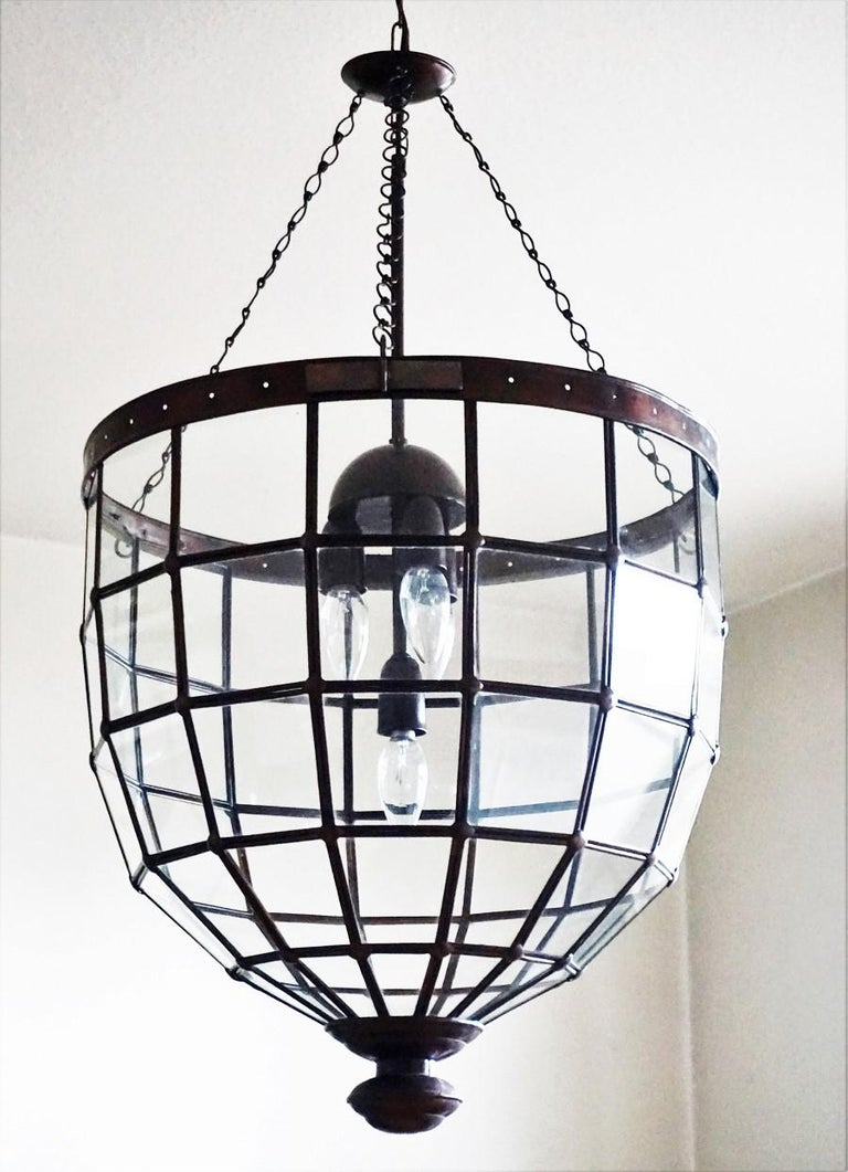 A large clear glass and copper lantern, Mid-Century Modern and Minimalist craftsmanship, Italy, 1930-1939. Geometric design with framed glass panels with a copper frame connecting together with copper rivets to a dome shape, central painted brass