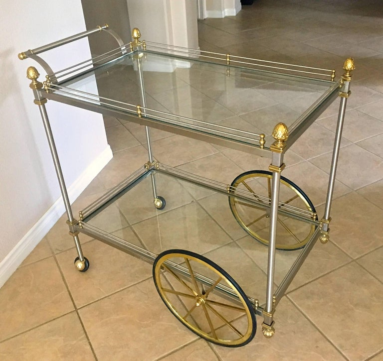 Larger scale brass and brushed steel Italian bar or tea cart, with two-tier glass shelves, gallery rail and acorn finial details.