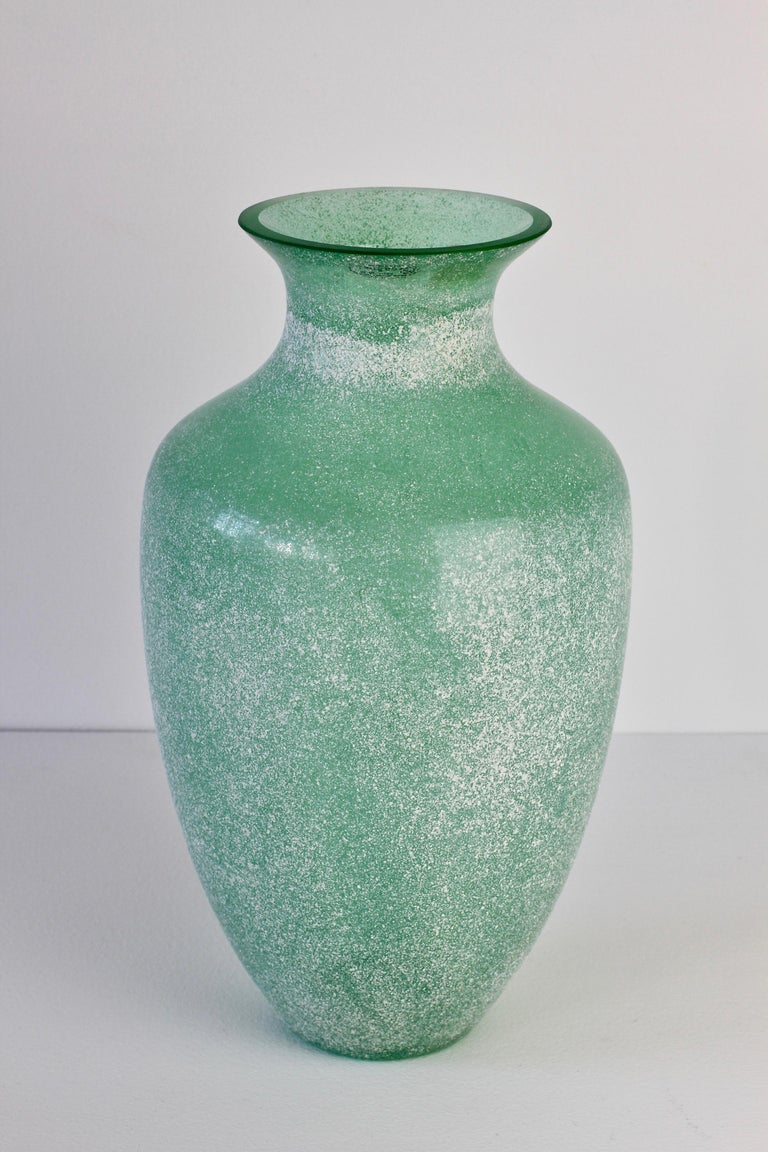 Large 35cm (13.5 inch) tall 'a Scavo' green colored / coloured glass vase by Seguso Vetri d'Arte Murano, Italy. Elegant in form and showing extraordinary craftmanship with the use of the 'Scavo' technique to replicate to look and feel of ancient