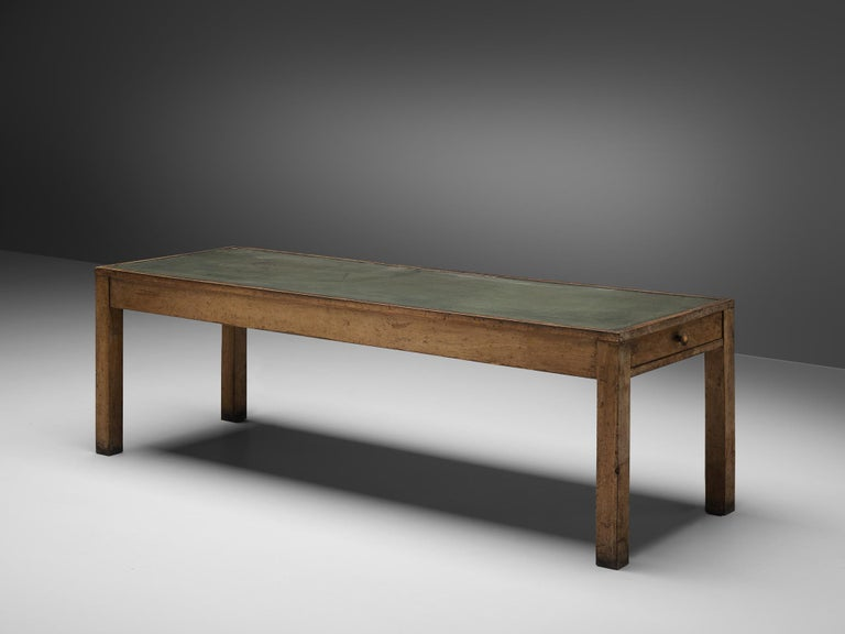 Large dining table, oak, brass, Italy, 1930-1940s  Sturdy dining table with two drawers. This large table stands on four square legs, placed at the corners. One drawer each is placed on the short side. The drawers open with round brass handles
