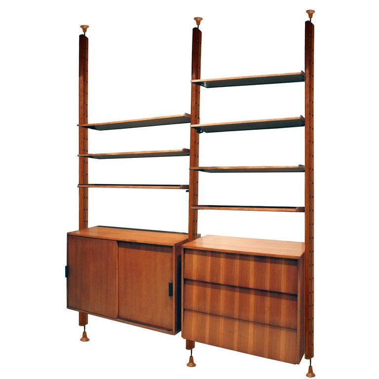 "Wall unit with adjustable shelving system, cabinet, chest and flip top desk in rosewood, teak and mahogany by I.S.A., Italian 1964 (label on desk that reads, ""ISA Bergamo Italy""). This wall unit is very versatile and beautifully made."