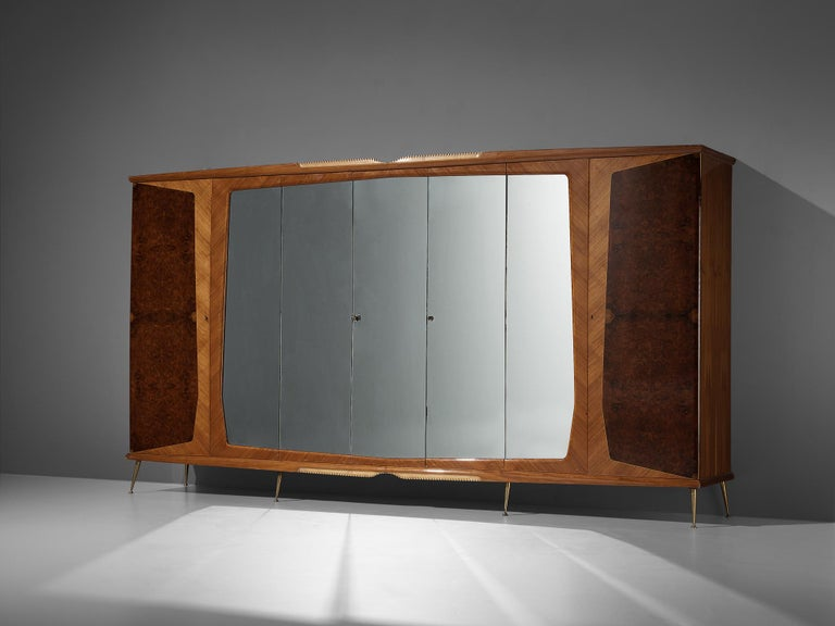 Large Italian wardrobe, mahogany, walnut burl, glass, brass, Italy, 1950s  With its seven doors this wardrobe has an impressive size. Five doors hold a mirrored surface, the two outer doors show luxourious walnut burl in combination with mahogany