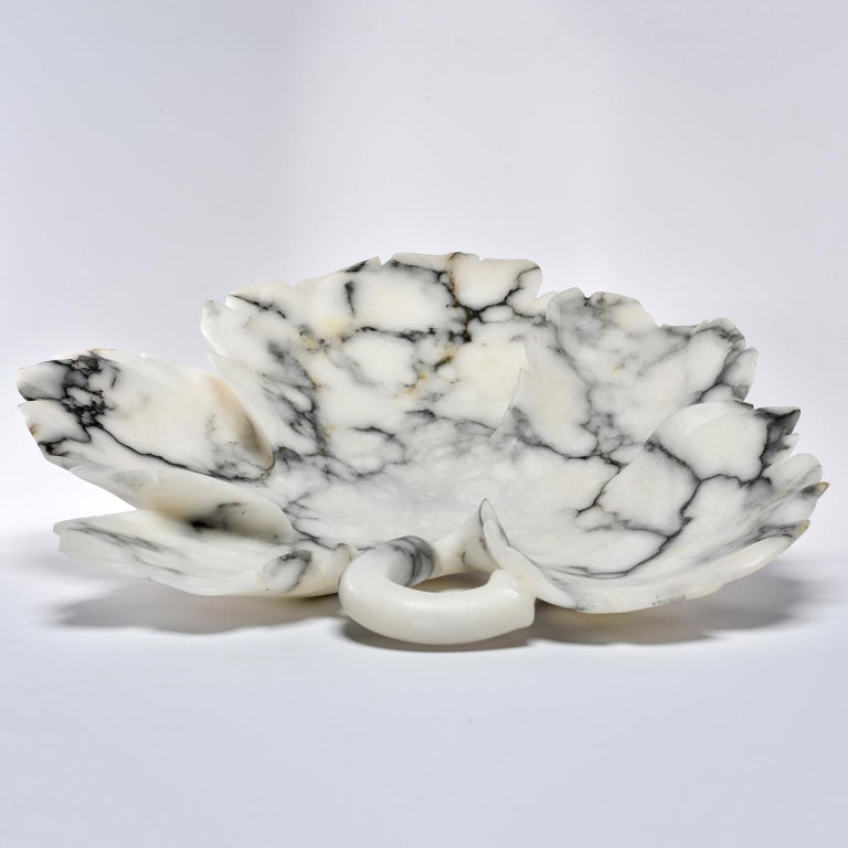 Custom made for us in Italy, this white alabaster platter or shallow bowl has gray veining and is in the form of a leaf.