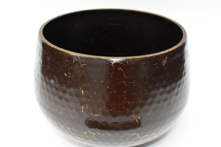 This is a large, substantial, handmade, antique Japanese singing bowl with a brown finish. The material is solid bronze. Beautiful dimpled texture in beehive pattern is hand-hammered. All patina is original. This bowl makes the most beautiful,