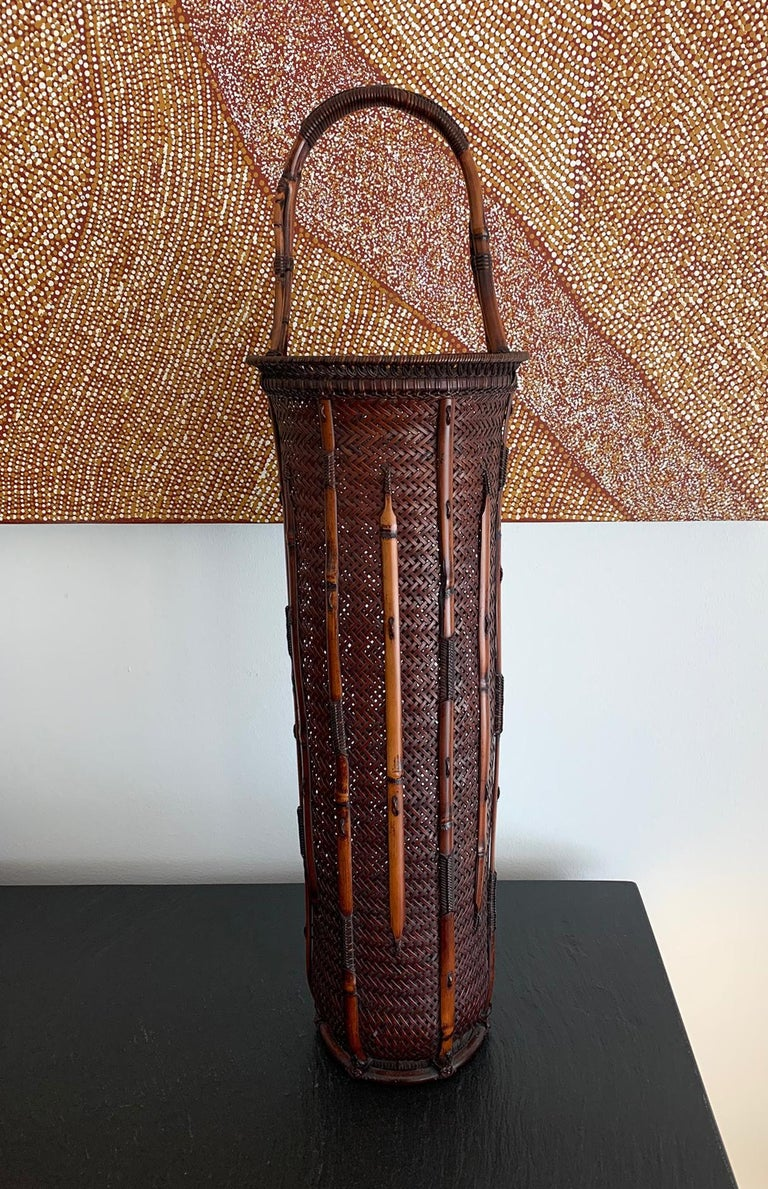 An important woven bamboo ikebana basket circa first half of the 20th century (Taisho or Showa era) by Japanese bamboo master Maeda Chikubosai I (1872-1950). Chikubosai I was from the Kansai Region and active in Sakai, Osaka prefecture. He was