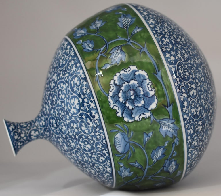 Exquisite large Japanese contemporary hand painted Imari porcelain vase in blue and green, the work of highly acclaimed award-winning master porcelain artist from the Imari-Arita region in Japan. The vase features a traditional Arita arabesque
