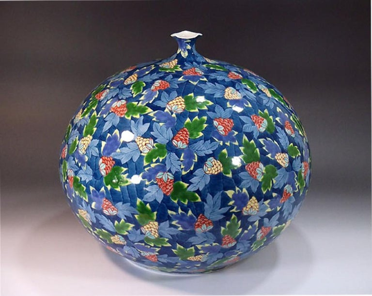 Exquisite large Japanese contemporary decorative Imari ceramic vase, hand-painted in vivid blue, red, green and yellow on a beautifully shaped ovoid ceramic vase, a striking piece hand painted and signed by a widely acclaimed master porcelain artist