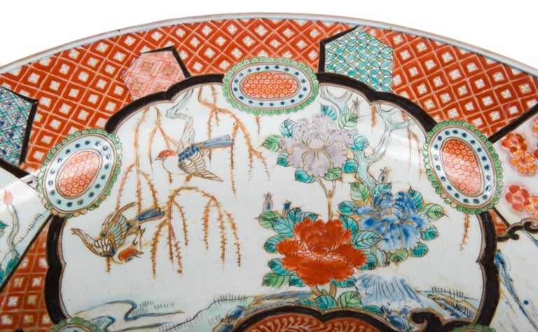 A very good quality 19th century Japanese Imari charger, having classical motif decoration to the ground, panels with exotic birds, mountainous scenes and flowers.