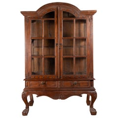Large Javanese Cabinet with Paneled Glass Doors, Bonnet Top and Cabriole Legs