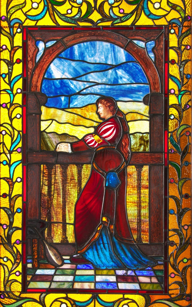 Exceptional quality stained glass panel, circa 1915, which depicts Juliet or a like maiden standing at her balcony. Incredible detail and color done by an unknown master of the art of working with glass. Condition is excellent without cracks or