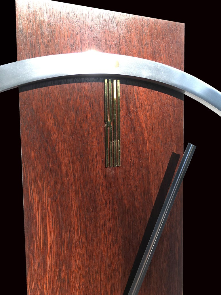 A fabulous larger than usual version of the kienzle wall clock, the main case is made from solid hardwood the ring is solid aluminum with brass insets at the 5 minute marks and brass Roman numerals at 12 and 6 o'clock (XII and VI) all in immaculate