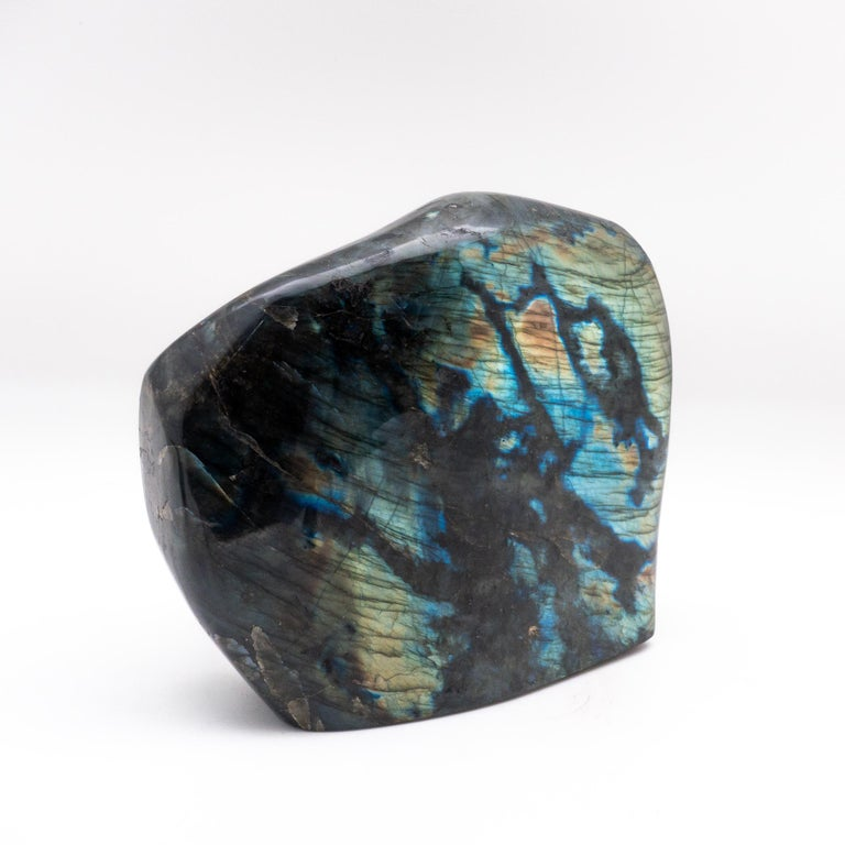 Large polished labradorite specimen. Labradorite displays an iridescent optical effect (or schiller) known as labradorescence. Labradorite is also know as stone that will help you become the person that you are destined to be. It will cleanse your