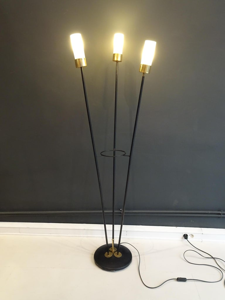 Large three-headed lamp in black lacquered metal, brass and white opaline. Italian work.   Dimensions: 153.5 cm maximum height, 5.5cm opaline diameter  Very good condition.