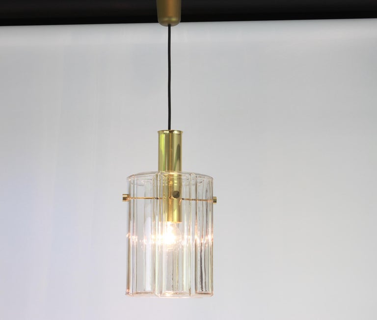 Brass pendant fixture with cylindrical glass shade design by Limburg, Germany, 1960s  Heavy quality and in very good condition. Cleaned, well-wired and ready to use. The fixture requires 1 x E27 Standard bulbs with 100W max each and function on a