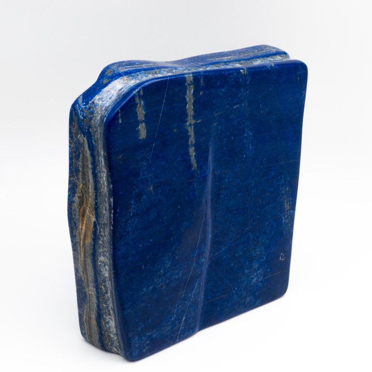 Beautifully polished lapis lazuli mineral specimen from Afghanistan. This semi-precious stone has been prized since antiquity due to its intense, beautiful blue coloring and golden speckles. It was also used in the fine arts, in a crushed powder