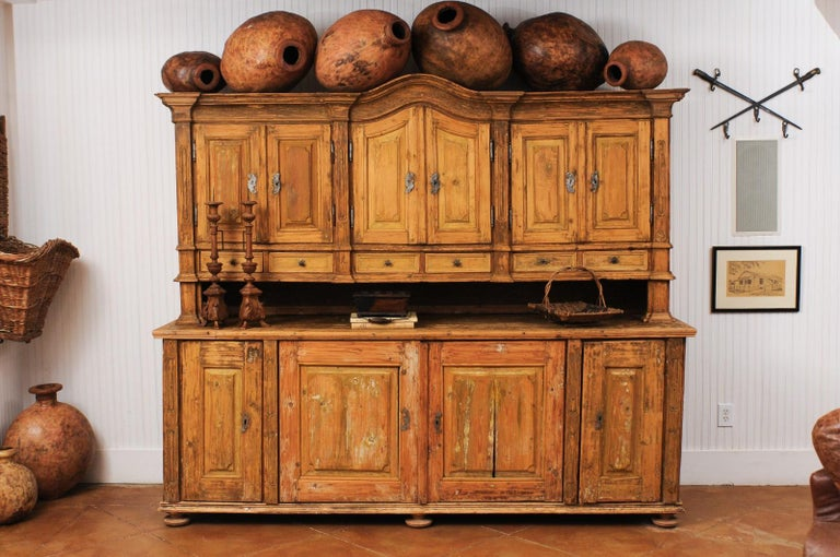 A large late 18th century French buffet à deux-corps in fir wood from a monastery near Avignon. Created in Southern France during the last decade of the 18th century, this buffet à deux-corps attracts our attention with its wonderfully weathered