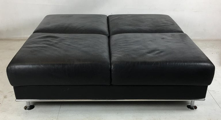 The mother of all ottomans by Kunihide Oshinomi for Matteograssi with heavy top grain leather and polished aluminum trim with chrome fluted feet. Matteograssi is one of the world's top maker's of luxury leather upholstered furniture and employs many