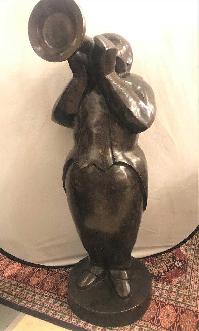 Large life-sized bronze modern sculpture of a trumpet player. SSXA.
