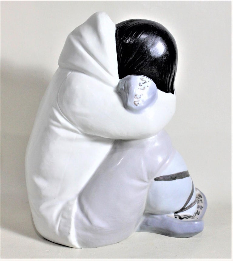 Large Lladro Yupik or Inuit Boy Crouched and Resting Figurine or Sculpture In Good Condition For Sale In Hamilton, Ontario