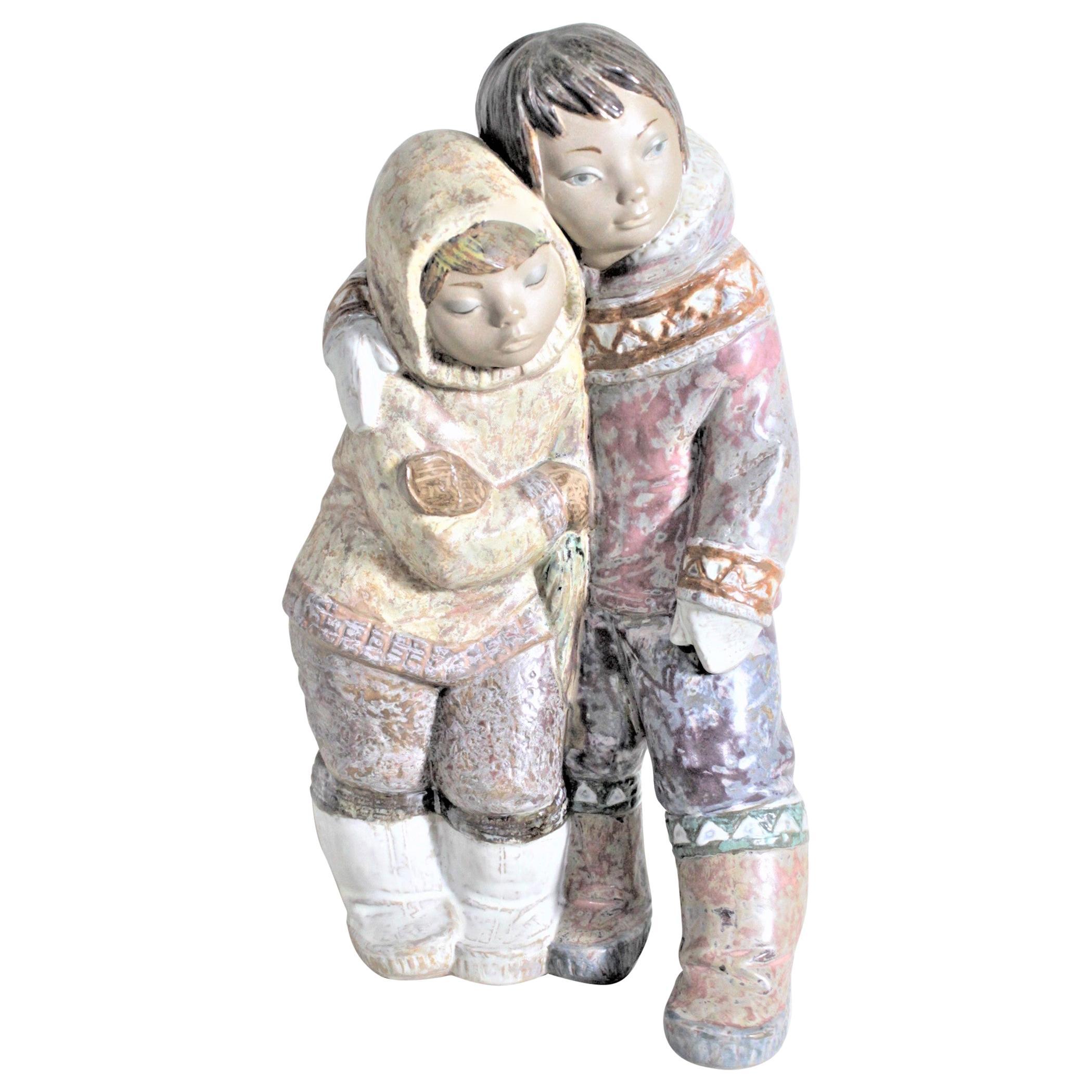 Large Lladro Yupik or Inuit Boy and Girl Affectionately Embracing Figurine