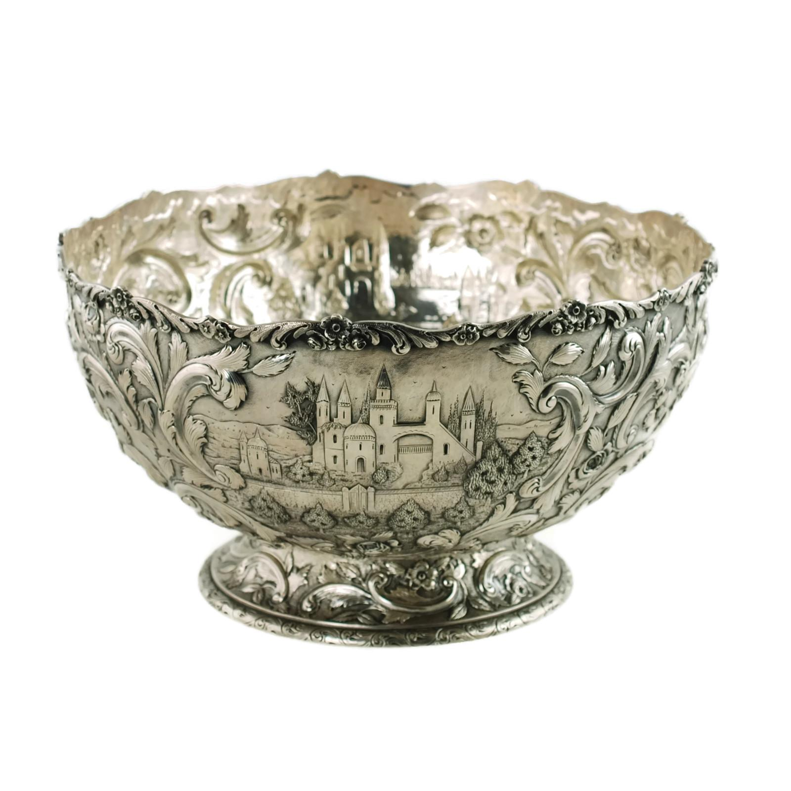 Large loring andrews sterling silver footed punch bowl repoussé castle pattern for sale at 1stdibs