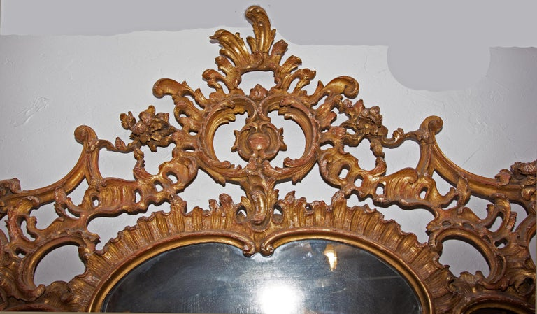 Large antique continental carved and gold gilt over mantel (fireplace) mirror, 19th century. Measures: 60