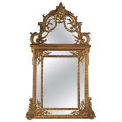 Large Louis XVI-Style Giltwood mirror With mask of Minerva, 19 th c.