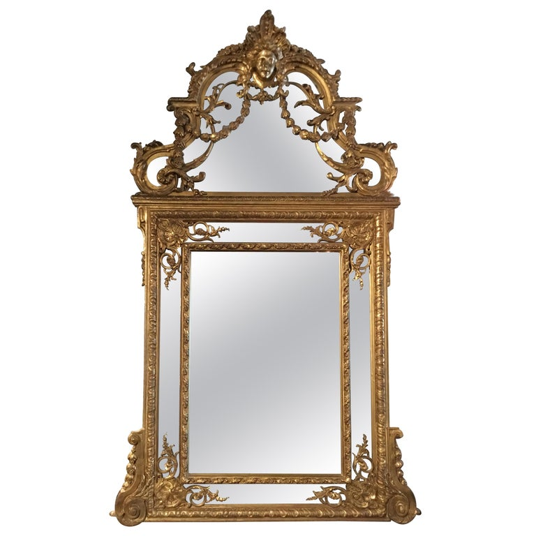 Large Louis XVI-Style Giltwood mirror With mask of Minerva, 19 th c. For Sale