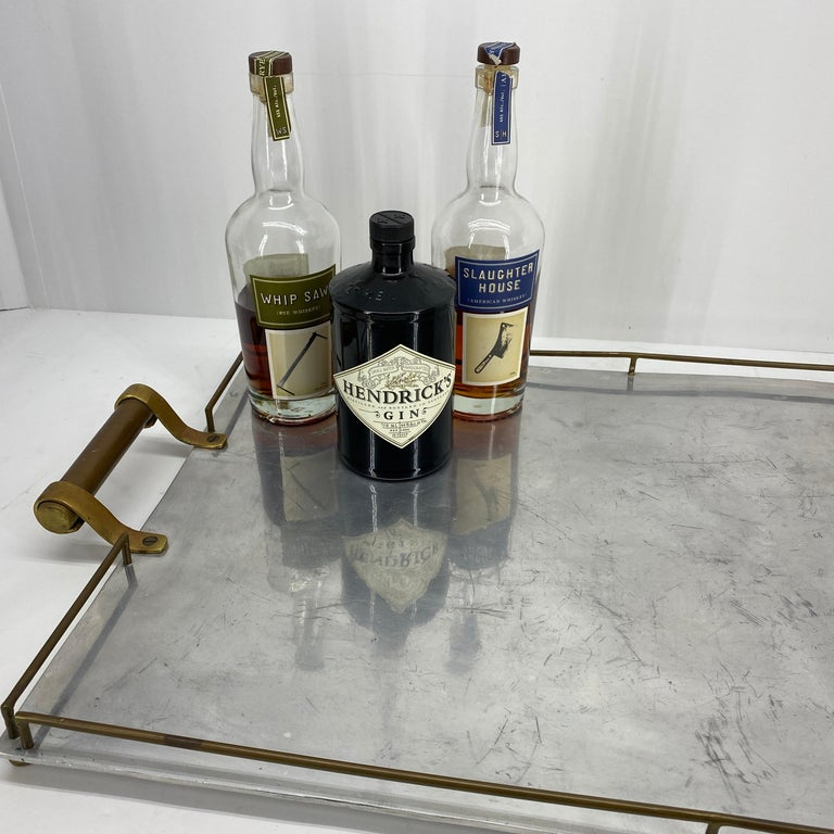 Large rectangular serving tray in chrome and with two side handles in brass. The tray is in great vintage condition. Minor wear consistent with age, one brass bar is bent. Please see detailed images attached.