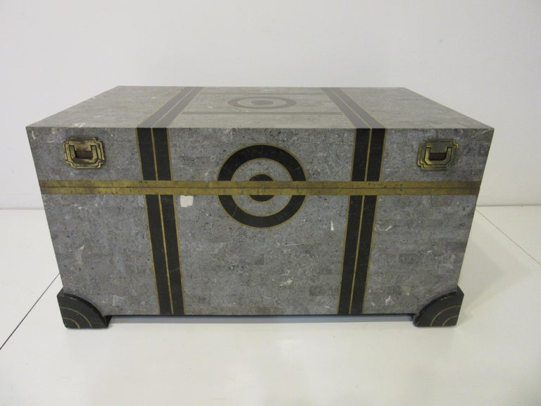 A well-crafted tessellated marble coffee table chest with gray, charcoal, mixed marble and inlay brass details to all sides. The inside is covered in a tight black velvet styled material as well as the bottom of the chest, the hinges and handles are