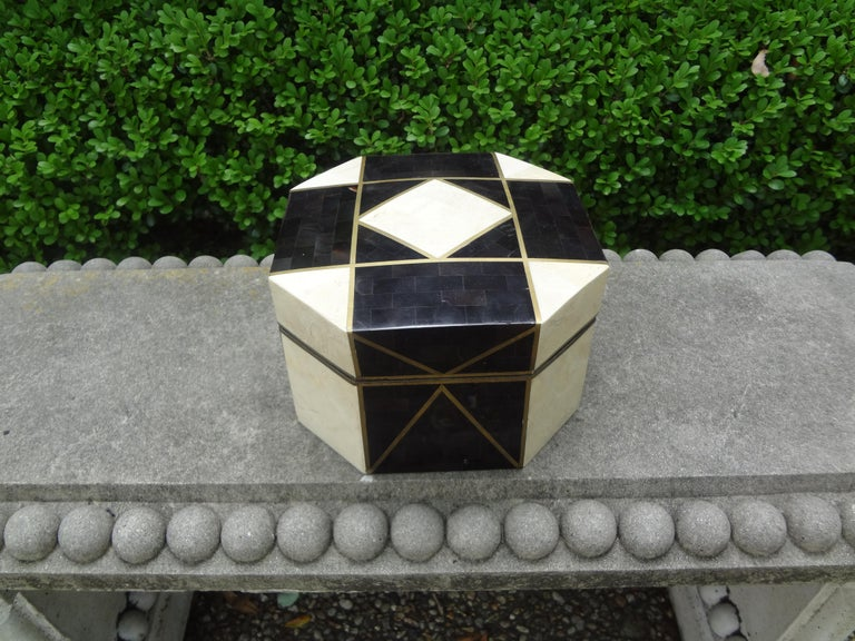 Stunning large geometric tessellated stone, horn and brass box in the style of Maitland Smith. This gorgeous octagonal shaped tessellated decorative box, coffee table box or jewelry box is comprised of tessellated pieces of white stone and black