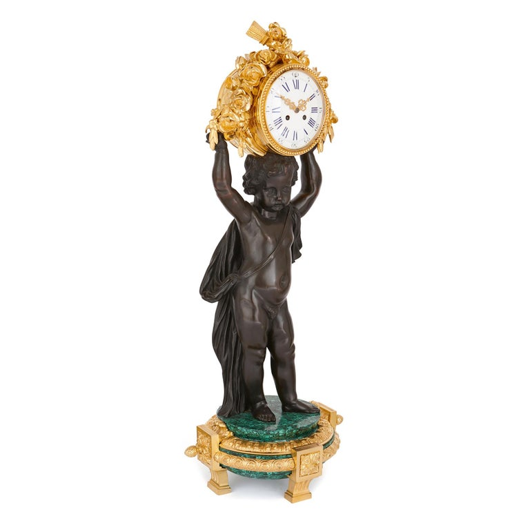 This majestic, neoclassical style clock set – the clock of which measures 1m and the candelabra 1m 11cm in height – will make a bold statement in an interior. With its magnificent patinated bronze putti, the design transcends the boundaries between