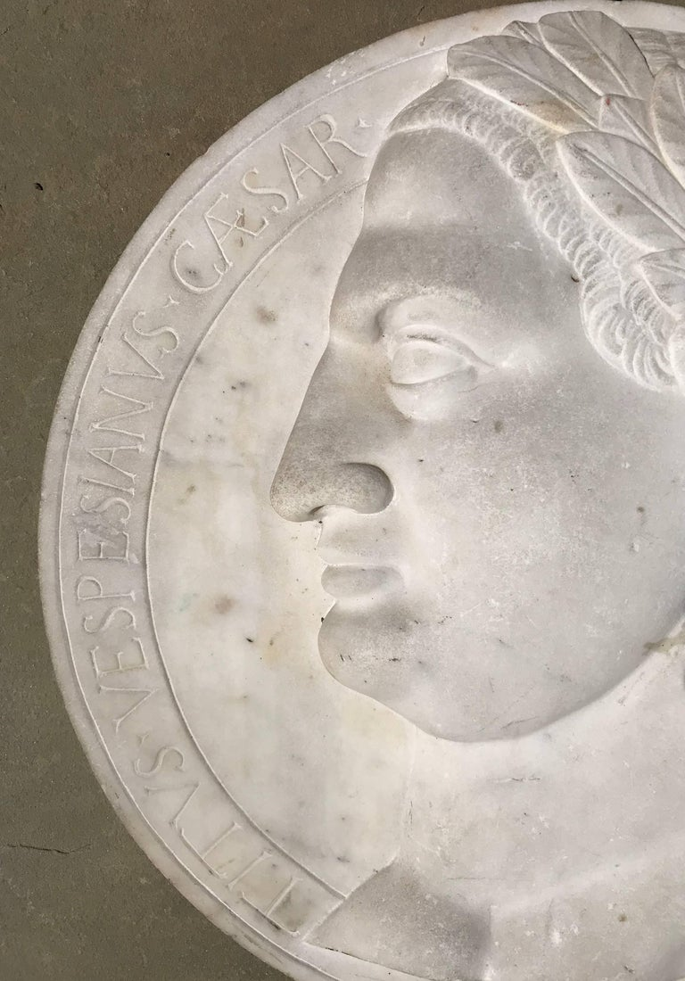 """Fine neoclassical Italian 16"""" diameter relief plaque of Caesar Augustus dating to the early 19th century. The deeply carved head of Caesar is decorated with a laurel wreath and surrounded with a Latin inscription: """"Caesar Augustus Imperator Titus"""