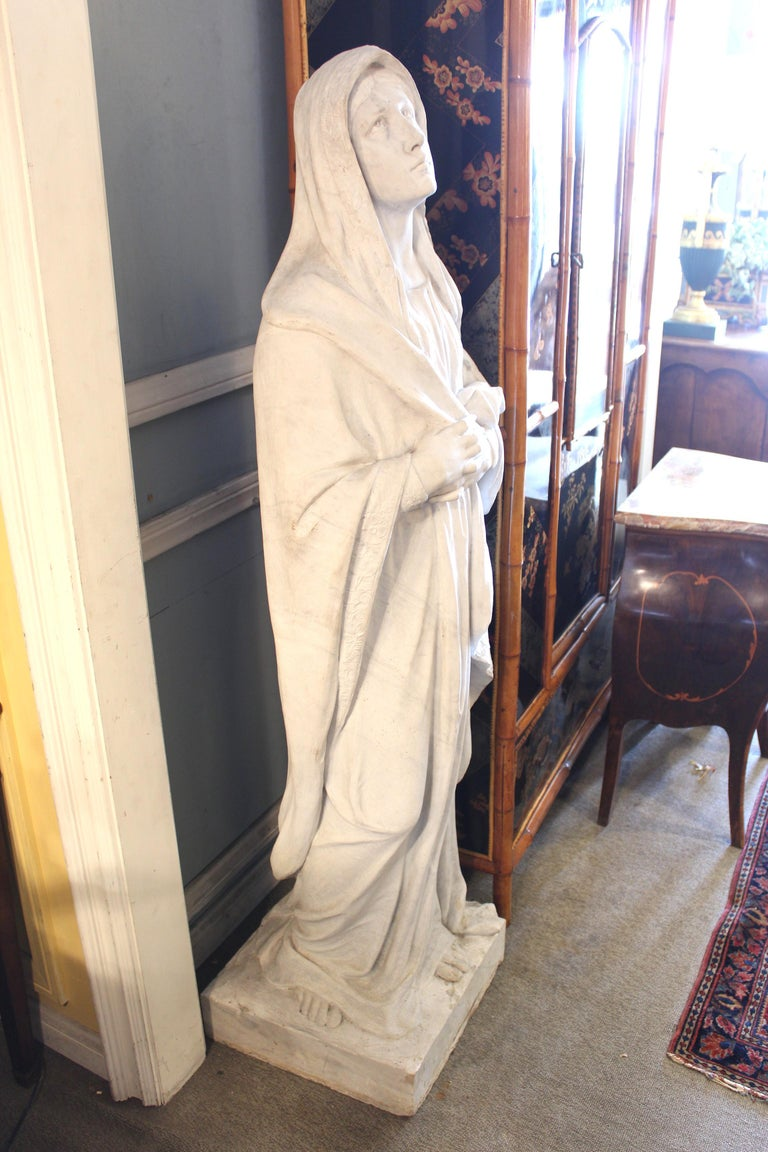 Large white marble statue of The Virgin Mary, early 20th century. This marble statue weighs approximately 300-400 pounds.
