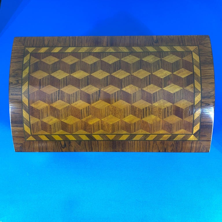 Large decorative marquetry jewelry box with dome lid and gilded feet.