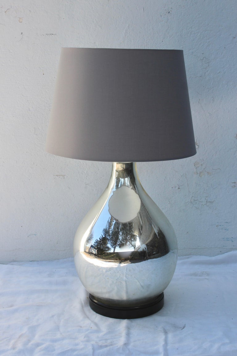 Large Mercury glass table lamp with painted black wood base and cloth covered twisted cord. Lampshade not included.
