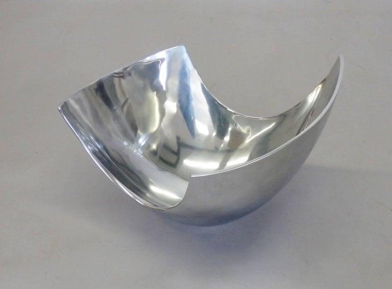 Large asymmetrically shaped aluminum bowl.