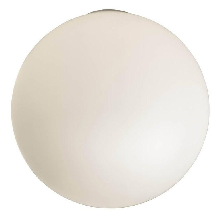 Michele De Lucchi Dioscuri outdoor wall or ceiling light. Dioscuri are a timeless fixture that diffuses a heavenly light. This multipurpose outdoor light features a minimalistic design that transcends time with its charm. UL Wet location listed,