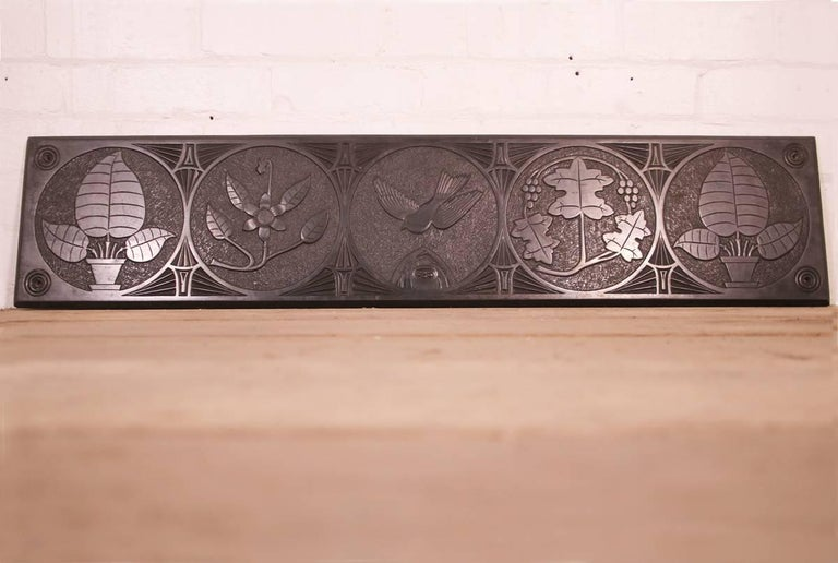 Large mid-19th century decorative Folk Art carved slate panel profusely decorated with geometric circles containing plants and flowers and a bird in flight to the centre circle, circa 1840.