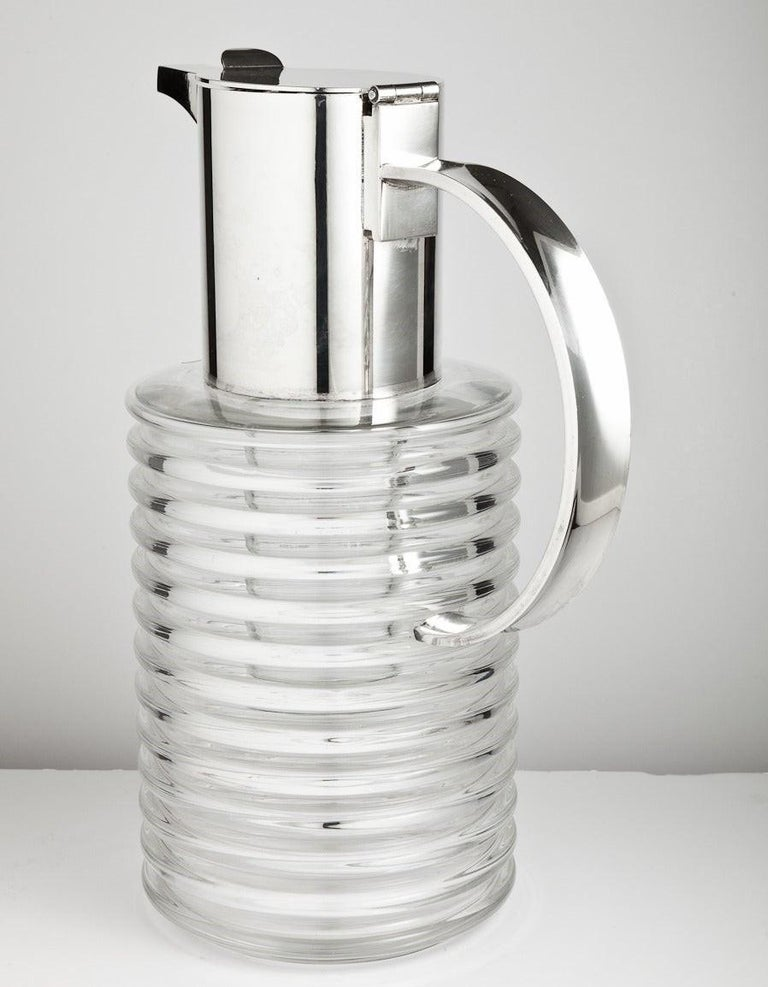 A large mid-20th century Italian glass and silver plated lemonade jug with integral ice container designed by Sergio Asti, Italy, circa 1965
