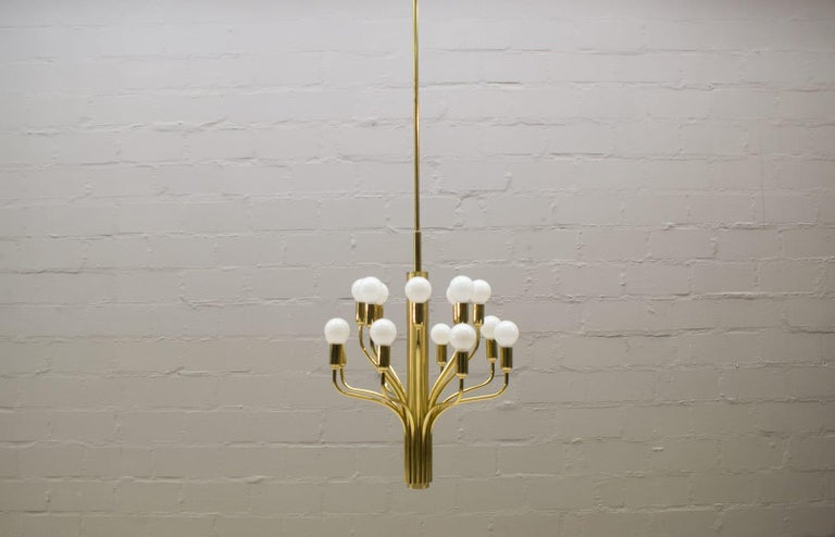 Large pendant lamp designed and manufactured by WKR Leuchten GmbH in Germany.  You need eighteen E14 Bulbs.