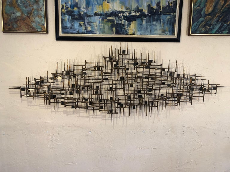 Large midcentury Brutalist nail wall sculpture attributed to Marc Weinstein. Amazing 3 dimensional hand welded and torch cut nail art with squares design. Perfect focal point for above a sofa or bed. No signature found. Can be hung vertically or