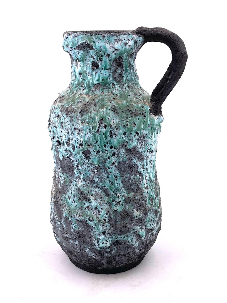 A very unique large ceramic pitcher in a Brutalist finish with lava glaze, circa 1970s great condition no chips or cracks.