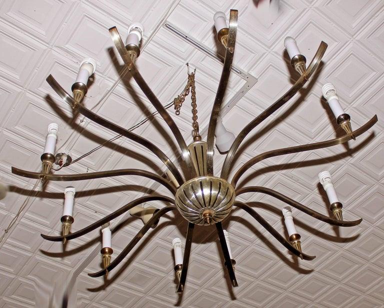 Large twelve arm Mid-Century Modern chandelier. Brass and white brass.60