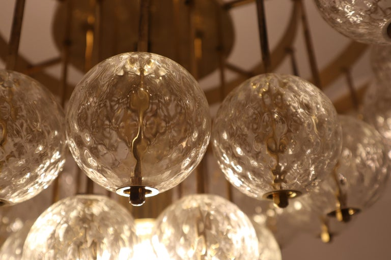 Large Mid-Century Chandelier with Brass Fixture and Structured Glass Globes For Sale 4